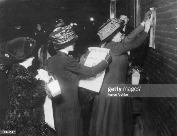 American suffragettes led by Miss Beatrice Brown posting bills advertising a lecture by the English suffragette Sylvia Pankhurst in New York