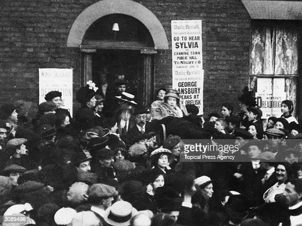 English suffragette and socialist Sylvia Pankhurst addressing the crowd from the suffragette headquarters in Old Ford Road Bow London