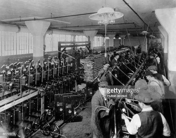 Workers on an assembly line inside the Ford Motor Company factory at Highland Park Michigan constructing steering systems