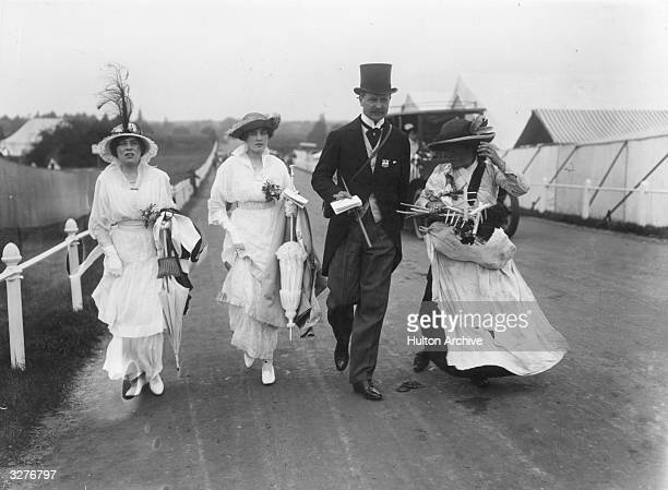 A contrasting picture of a gypsy approaching society ladies at Ascot