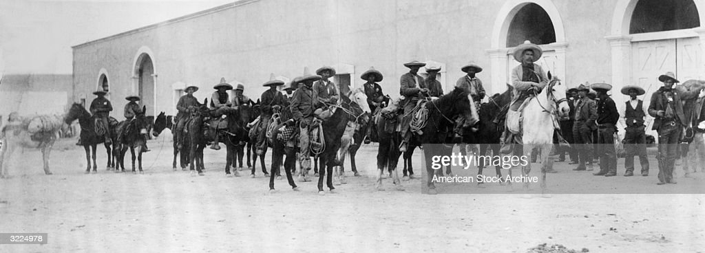 Panoramic view of Mexican revolutionary Pancho Villa (1877 - 1923) and his followers on horseback, Mexico.