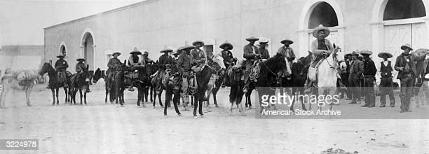 Panoramic view of Mexican revolutionary Pancho Villa and his followers on horseback Mexico