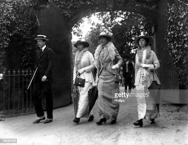 The honourable Ralph Beaumont and his mother and two young women at Eton.