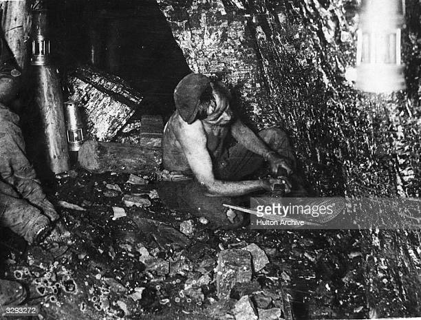 A British coal miner at work