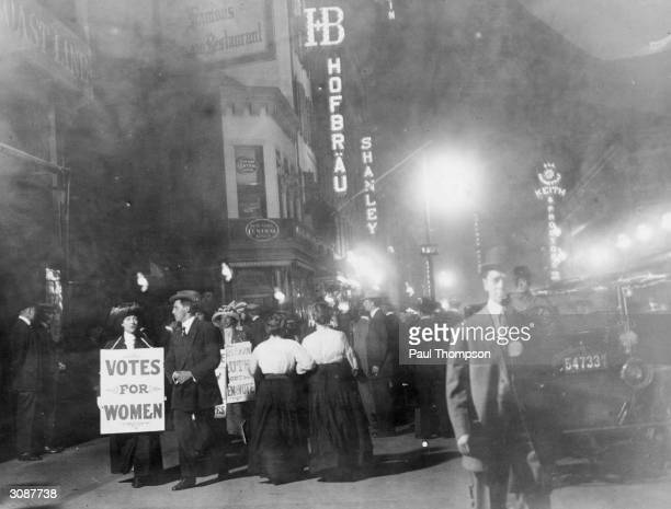 A group of suffragettes campaigning for votes for women on New York's Broadway