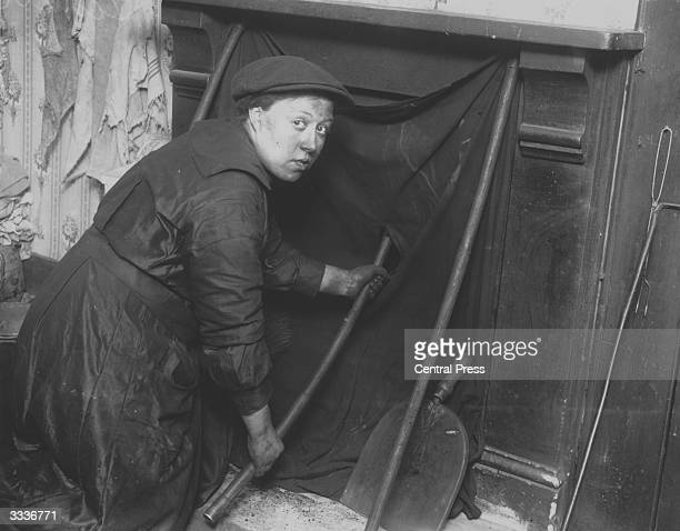 A woman chimney sweep during World War I at Camberwell in London Published as part of the Silver Jubilee Series in 1935