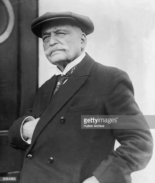 Auguste Escoffier the French chef otherwise known as 'King Of The Kitchen' is standing in napoleonic pose by a door He wrote several famous cookery...