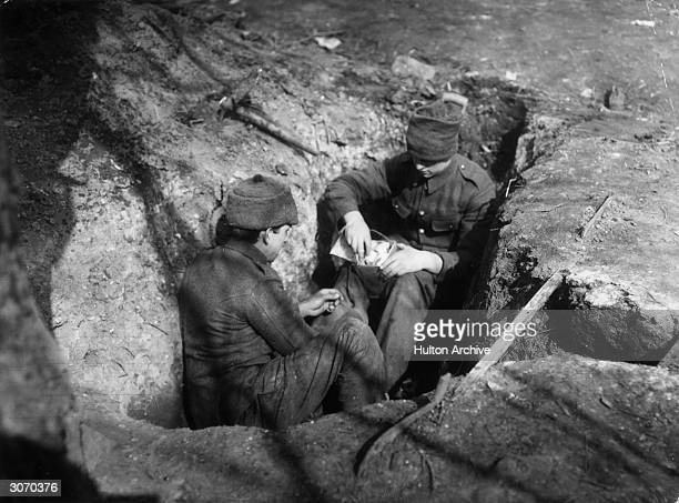 British soldiers making grenades from tins in the trenches
