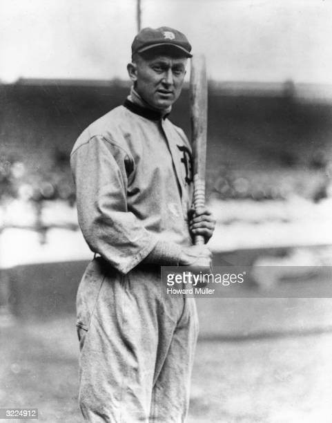 Detroit Tiger Ty Cobb posing in his uniform and holding a bat.
