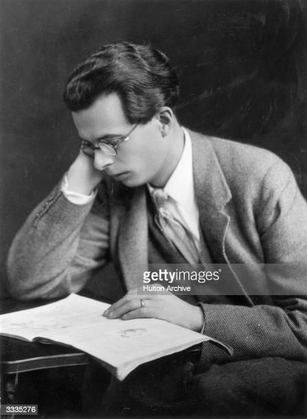 English novelist Aldous Leonard Huxley reading a book