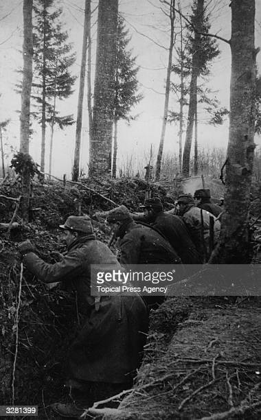 French soldiers crouching down in a trench
