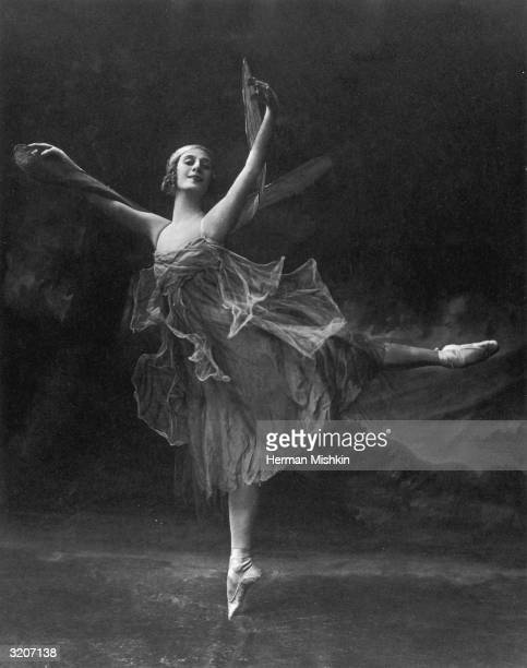 Fulllength portrait of Russian ballet dancer Anna Pavlova performing an Arabesque while dancing on point in a costume with wings