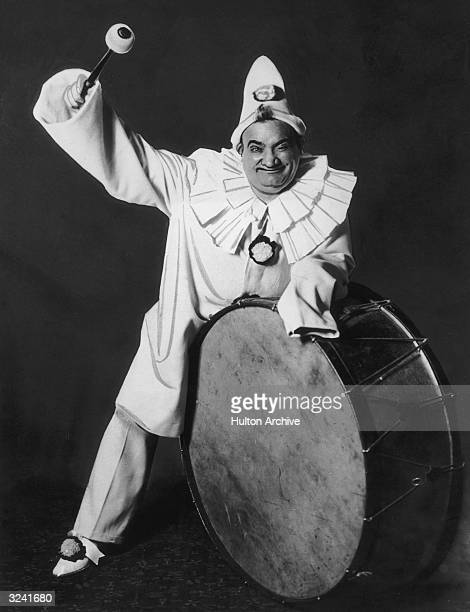 Fulllength promotional portrait of Italian tenor Enrico Caruso as Canio from Leoncavallo's opera 'I Pagliacci' 1910s dressed in clown costume and...