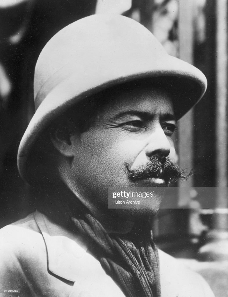Headshot of Mexican Revolutionary leader Pancho Villa (1877 - 1923) wearing a military general hat and handlebar mustache.