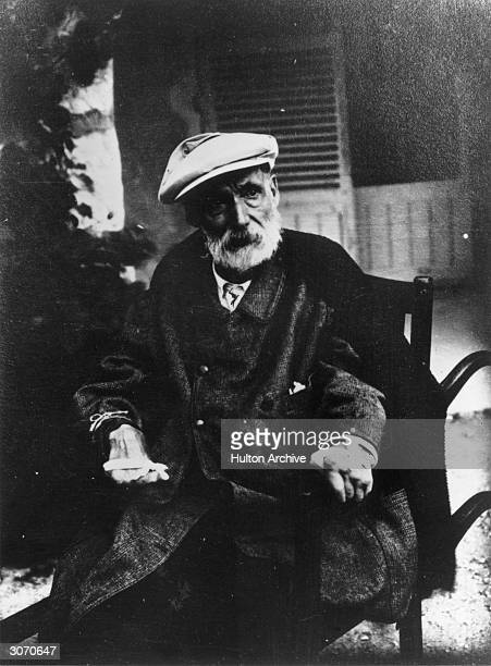 Impressionist painterPierre Auguste Renoir at his home Les Collettes Cagnes France His hands are crippled with arthritis