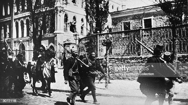 Soldiers of the Young Turk Army from Salonika arriving in Constantinople In the background can be seen the shattered windows of the barracks