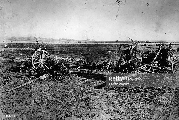 A battlefield in Flanders showing abandoned and destroyed guns