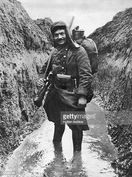 A French Soldier standing in a muddy trench WWI