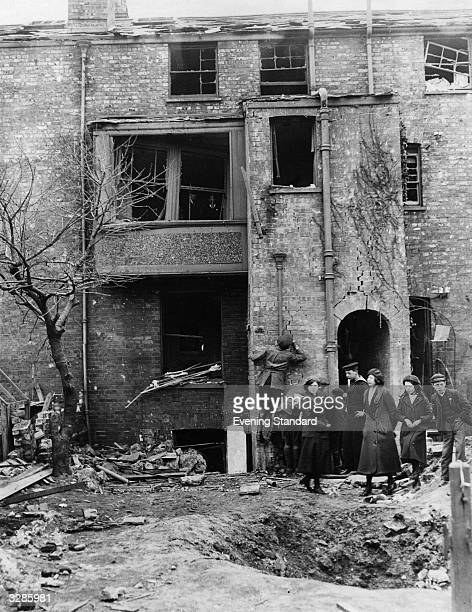 A group of residents check a damaged house after a zeppelin raid on Lowestoft during the First World War