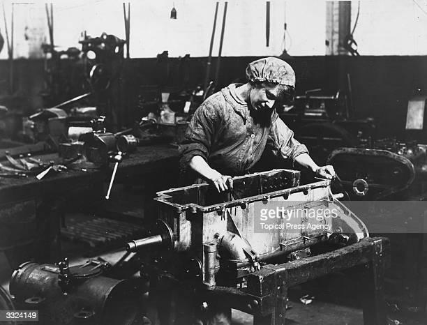 A woman war worker working on an engineering shop floor