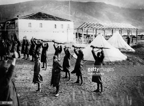 Albanian infantry soldiers undergoing gun practice