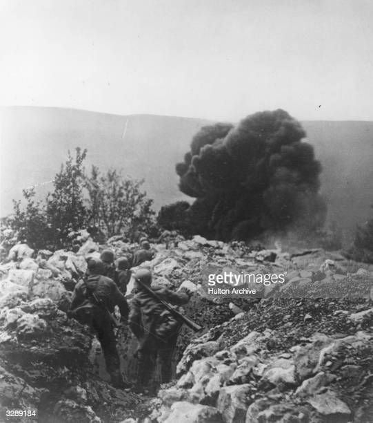 Austrian troops advance with flame throwers during the Isonzo campaign