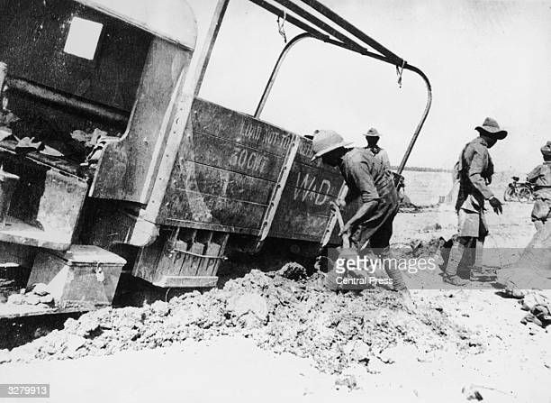 British soldiers digging out a truck in Mesopotamia during World War I