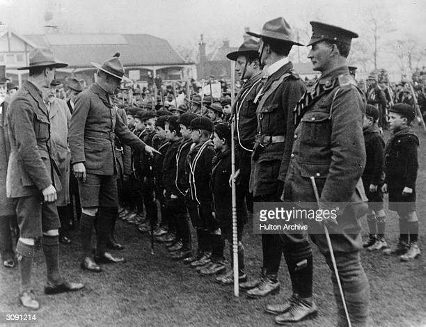 English soldier Robert Stephenson Smyth 1st Baron BadenPowell founder of the Boy Scouts inspects a parade of Wolf Cubs during World War I