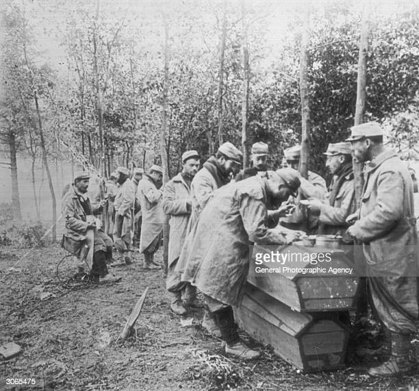 French soldiers in WW I using coffins as dining tables