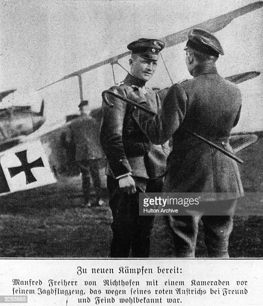 German First World War air ace Manfred von Richthofen known as the Red Baron, leader of the 11th Chasing Squadron, with a comrade in front of his...