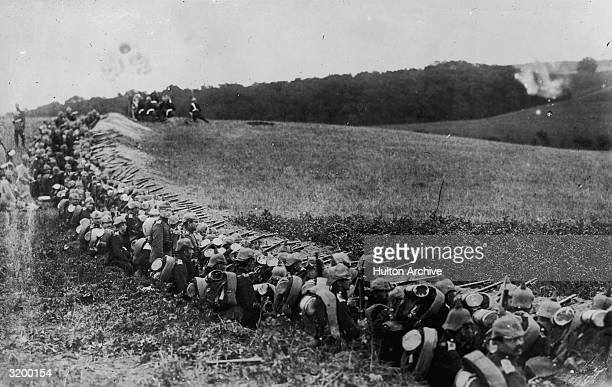 German troops in trenches with guns at the ready in East Prussia possibly at Tannenberg