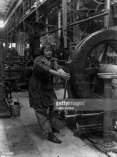 Girl operating a ripling machine at New Gun factory Royal Arsenal Woolwich