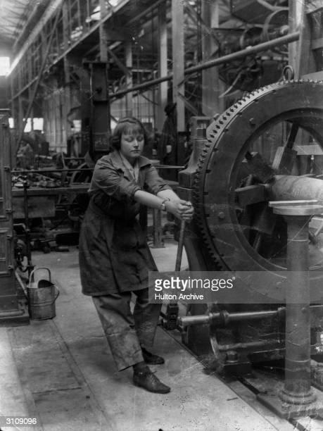 Girl operating a ripling machine at New Gun factory Royal Arsenal Woolwich