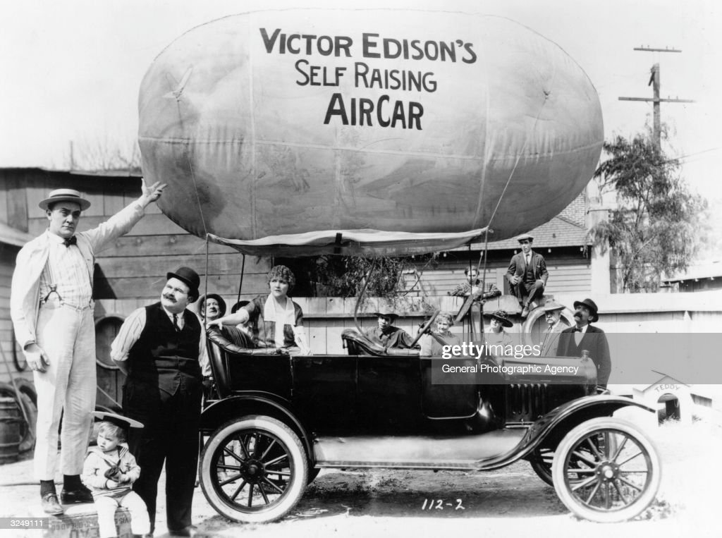 In a scene from Mack Sennett's latest all star comedy 'Skylarking', Harry Gibbon explains the workings of his new invention the Self Raising Air Car.