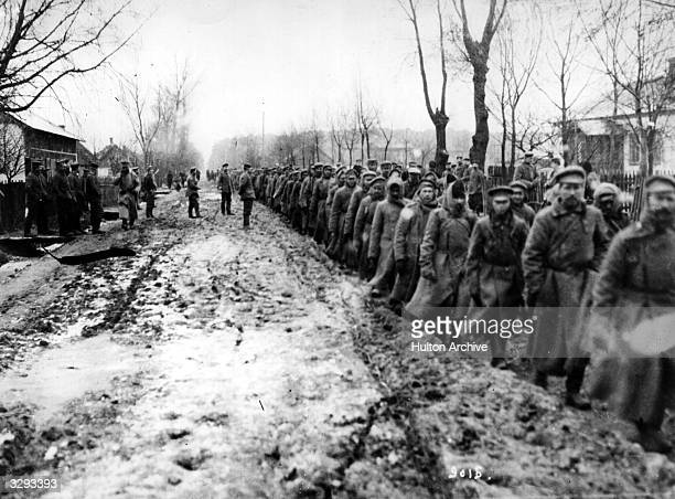 Russian prisoners being marched into German Headquarters