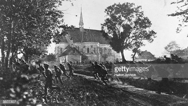 Russian soldiers flee through a village after a provocateur announced that the German cavalry have broken through.