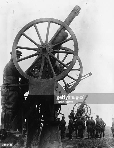 Soldiers of the Belgian army operating two large 77 mm antiaircraft guns during World War I