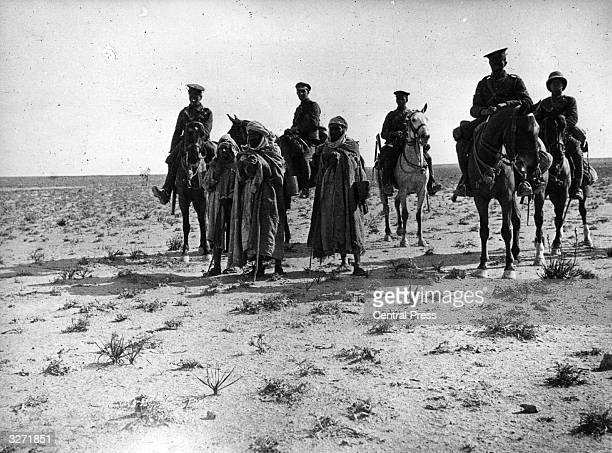 Soldiers on horseback in the Iraqi desert during the Mesopotamian campaign