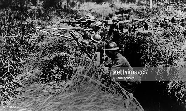 American troops firing from a trench on the Western front
