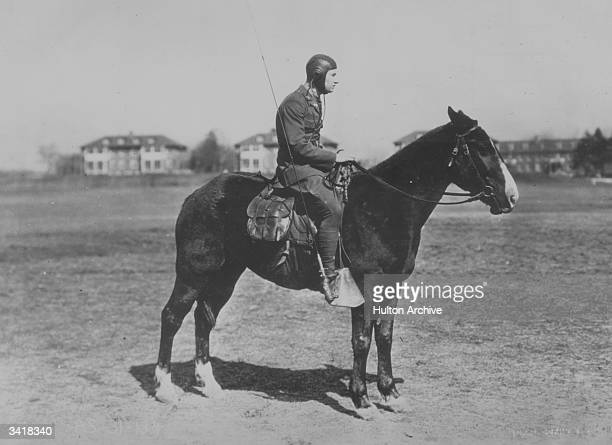 An American mounted cavalry man with a radio receiving set complete with fishpole aerial attacheed to his stirrup
