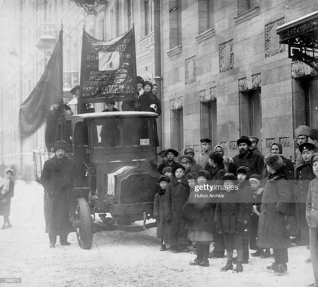 Bolsheviks and their banners in a street at Petrograd (St Petersburg) during elections for the constituent assembly. Original Publication: Russian Album