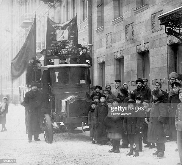 Bolsheviks and their banners in a street at Petrograd during elections for the constituent assembly Original Publication Russian Album