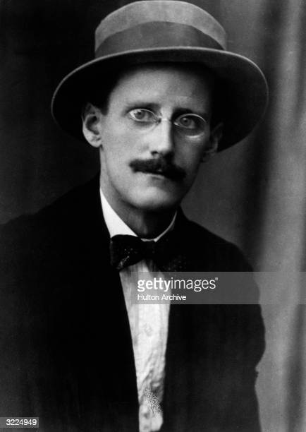 Portrait of Irish author James Joyce wearing a hat pincenez eyeglasses a jacket and a bow tie Zurich Switzerland