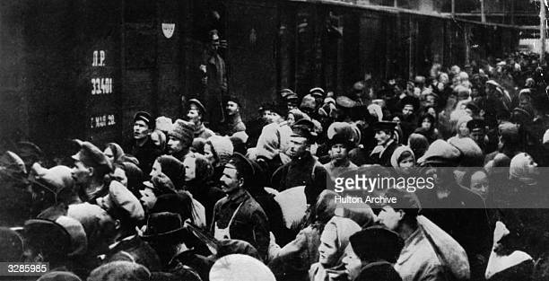 Russian peasants mobbing a train during the Russian Revolution
