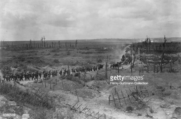 A German column advances across the fertile fields of Champagne a small section of the vast horde that from 1914 1918 was settled upon NorthEastern...