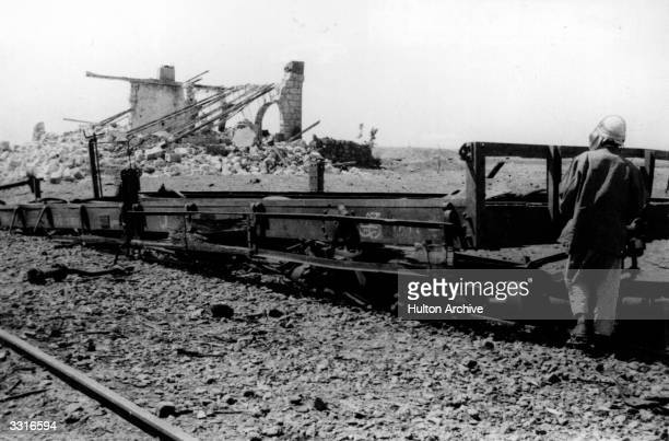 British soldier adventurer and author Thomas Edward Lawrence known as Lawrence Of Arabia surveys the results of a trainwrecking mission He joined the...