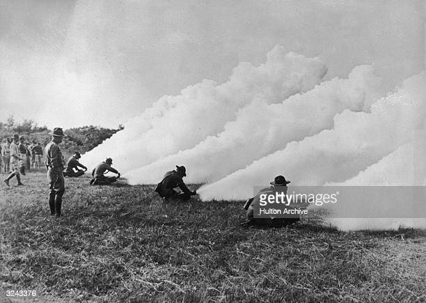 Students releasing smoke from chemical cylinders at the Army Chemical Warfare Service School at Edgewood Arsenal Maryland World War I The school...