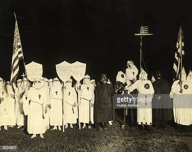 The Royal Riders of the Red Robe and the Ladies of the Invisible Empire, branch groups of the Ku Klux Klan , at a night gathering with the social...