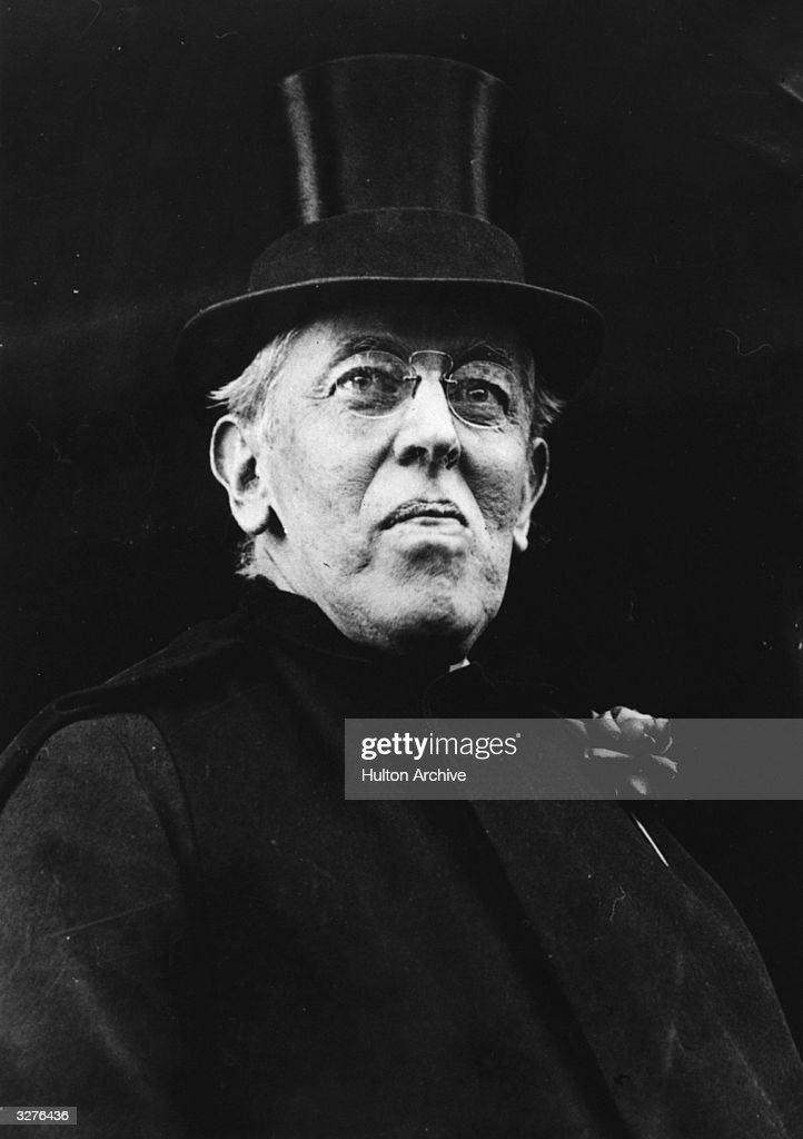 Woodrow Wilson (1856 - 1924), the 28th President of the United States in top hat.