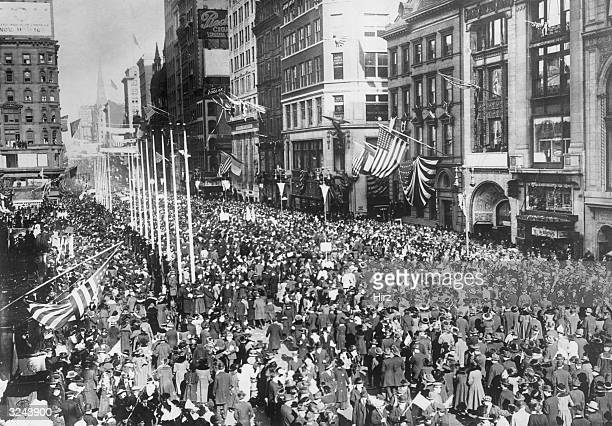 A huge crowd throngs Fifth Avenue during a Victory Parade celebrating the end of World War I New York City American flags are visible